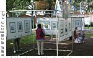 """Reizende Bilder - Cartoons""  an der Promenade in Podersdorf"